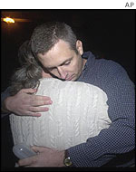 Gary Proctor (r)  hugs Walt Britt after the execution