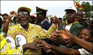 President Robert Mugabe greets his supporters