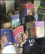 Children reading Harry Potter