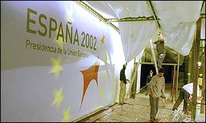 Workmen make finishing touches for the Barcelona summit