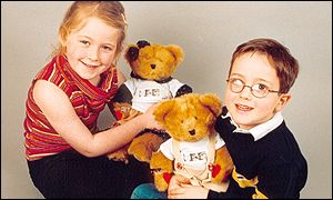 Children with teddies Rufus and Ruby