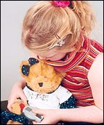 Child with Ruby the teddy from KIDSAC