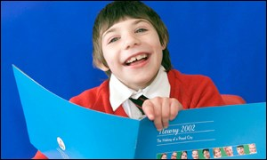 Boy with Newry campaign literature