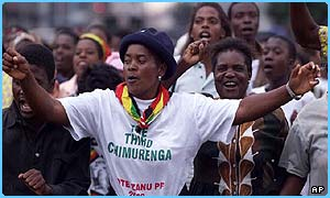 Robert Mugabe supporters celebrate the Zimbabwe election result