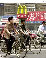 Cyclists pass McDonalds