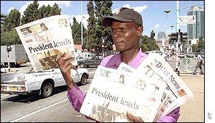 A newspaper seller in Harare