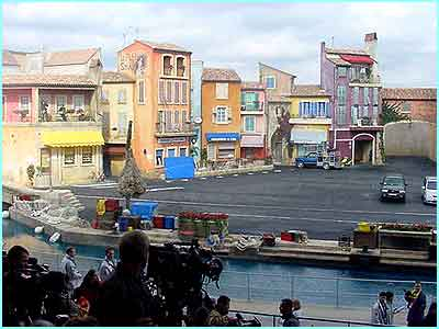 The whole thing is as a film set would be. The stunts take place in a pretend French town