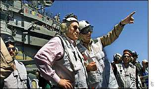 Dick Cheney (in pink shirt) aboard the USS Stennis