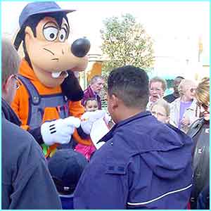 The job of a Disney character is never done! Goofy signs autographs