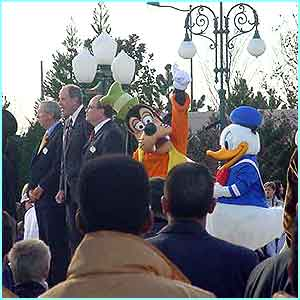 Goofy waves to the crowd as the opening ceremony speeches are made by officials including Roy Disney