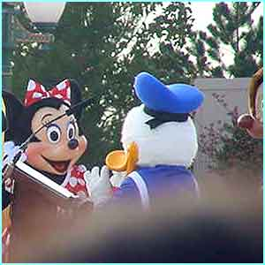 Meanwhile, Minnie has a quick squeak with Donald Duck