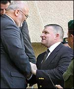 Anthony Zinni, right, with top Palestinian negotiator Saeb Erekat