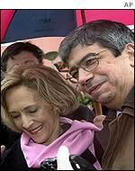 Eduardo Ferro Rodrigues, socialist leader, casts his vote in the rain with his wife Filomena