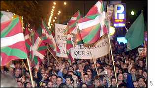 Basque nationalists brandish their flags in Barcelona