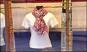 Shop window shows shirt