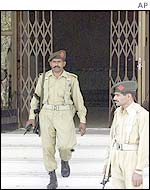 Pakistani troops guard the Islamabad church after the attack