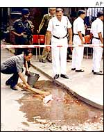 Cleaner washes bloodstains after the attack on American Centre in Calcutta