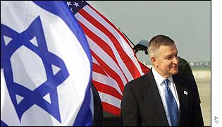 US envoy for the Middle East Anthony Zinni beside US and Israeli flags in Tel Aviv