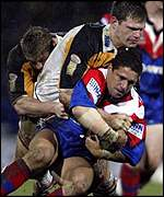 Newcastle's Robbie O'Davis is tackled during the World Club Challenge