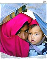 Afghan woman and child in Dashti-Arzana refugee camp near Mazar