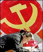 Chinese girl signs up for the Communist Party