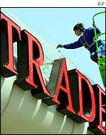 Man painting China's World Trade Centre sign