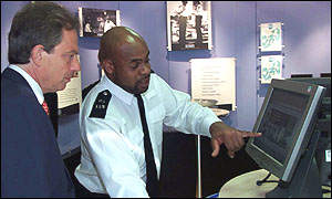 Tony Blair and a police officer.