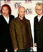 Guitarist Peter Buck with other members of REM