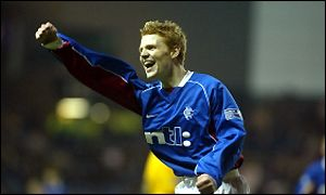 Chris Burke celebrates his debut goal for Rangers