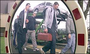 Apprentice mechanics leave the Vauxhall car factory in Luton