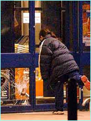 The drama started when a local photogragher spotted an 11-year-old girl hurling a brick through a shop window in Bristol