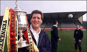 Partick manager John Lambie poses with the Scottish Cup