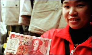 Chinese girl holding up a yuan note