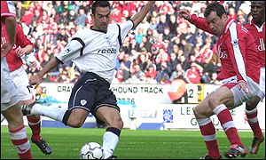 Youri Djorkaeff fires Bolton into the lead