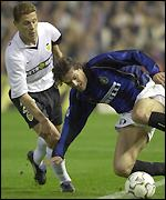 Inter Milan's Gugli shields the ball from Valencia's Curro Torres