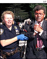 Officer Moira Smith helps a man from the World Trade Center