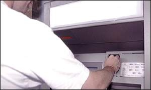 Cash being withdrawn from bank machine