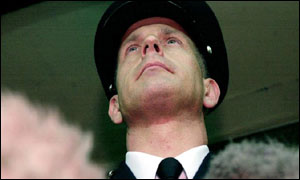 Commander Brian Paddick speaks to the waiting outside Brixton Police Station Monday March 18, 2002