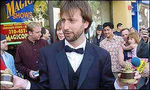 Tom Green with some of his Razzie awards