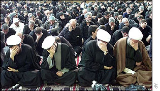 Clerics hold their heads and weep as they listen to stories of Muslim Shia leader Hussein