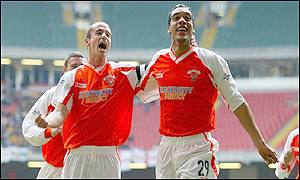 Chris Clarke celebrates his goal with Ian Hughes