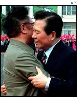 South Korean President Kim Dae-Jung, right, is embraced by North Korean leader Kim Jung II
