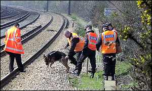 Police search railway line for Amanda Dowler