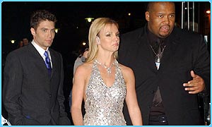 Britney Spears with security guards