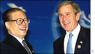 Chinese President Jiang Zemin and US President George W Bush at the Apec conference in Shanghai
