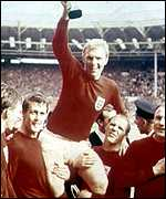 The England team celebrates victory in the 1966 World Cup final