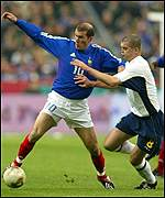 Scotland's Dominic Matteo tries to get to grips with Zinedine Zidane
