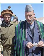 Mr Karzai with officials