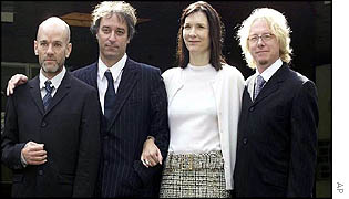 Michael Stipe, Peter Buck, his wife Stephanie and Mike Mills pose outside Isleworth Crown Court