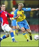 Wales' John Robinson takes on Tomas Rosicky